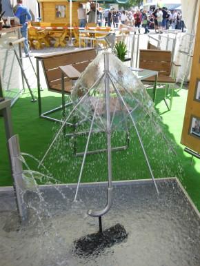 Regenschirm Springbrunnen